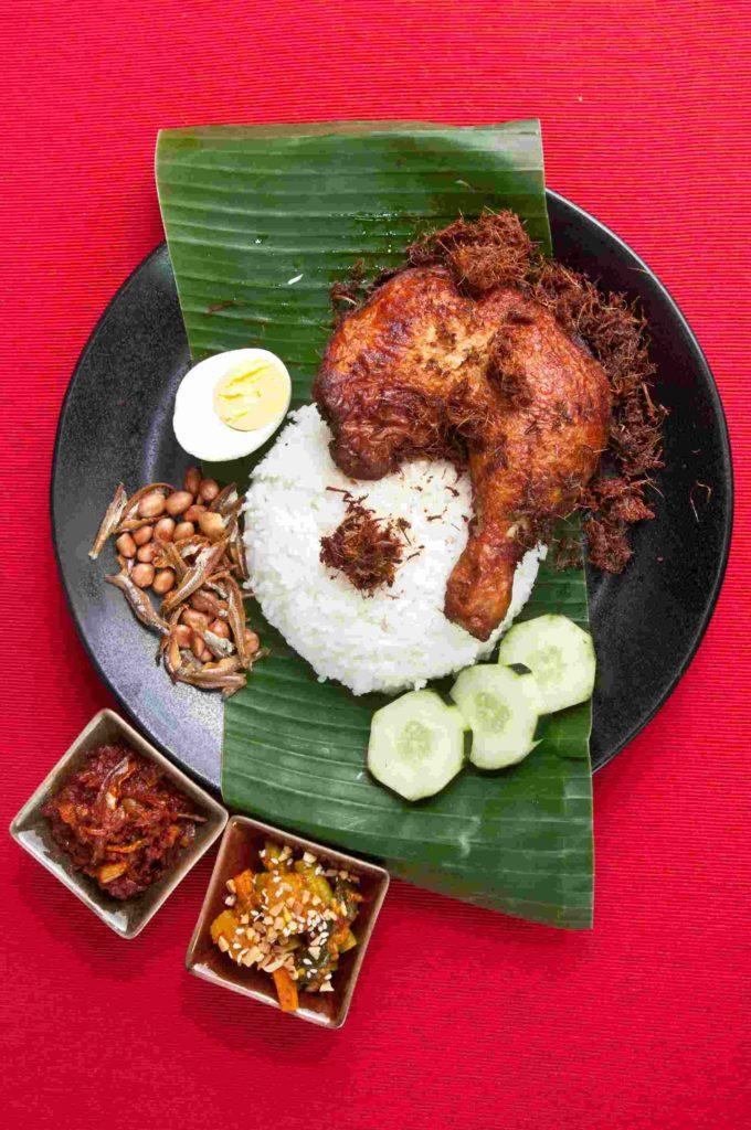 Uptown Nasi Lemak, pictured with ayam goreng berempah and Nyonya acar.