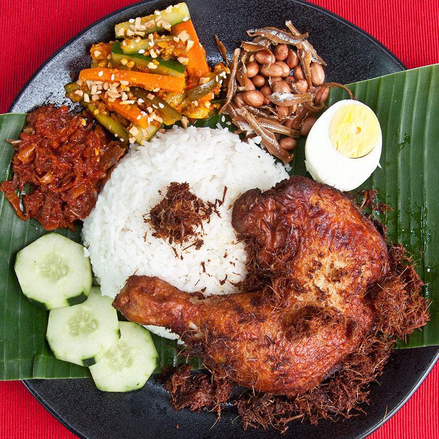 plate of nasi lemak with ayam goreng berempah